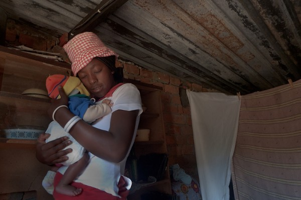May 2009: Tasila Lungu cuddles her infant son, Felix, at their home on the outskirts of Lusaka. Felix is six weeks old and has just returned from the Chelstone Clinic where he tested HIV negative.